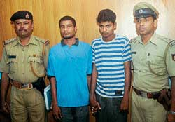 Police officers along with the accused who were arrested in theft cases in Sullia. DH photo