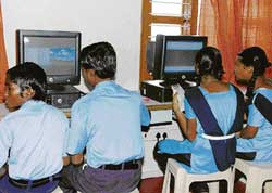 Schoolchildren from flood-affected families use computers at a centre opened by SAP and Hope foundation on the outskirts of Jageeravenkatapura in Raichur taluk on Friday. KPN