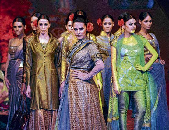 Neha Dhupia and models pose in J J Valaya's winter fall collection.
