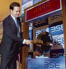 UK Chancellor of Exchequer George Osborne strikes the opening bell during his visit to the Bombay Stock Exchange in Mumbai on Wednesday. PTI