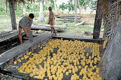Farmer busy in  jaggery making at a unit in Chamarajanagar district.  DH photo