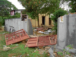 The compound wall of the house of a worker that the BGML security guards brought down, in the Italian Block of Marikuppam, Kolar Gold Fields, on Wednesday. DH PHOTO