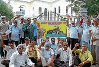 Members of Ideal Jawa Employees Union staging a protest in front of DC's office in Mysore on Wednesday. dh photo