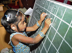 Rare talent: Shalini using her both hands to write  alphabet of different languages. DH PHOTO