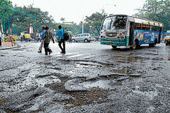 Pothole ridden road near Vishveshwaraiah Circle.