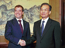 Russian President Dmitry Medvedev (left) shakes hands with Chinese Premier Wen Jiabao before their meeting at Zhongnanhai in Beijing on Monday. REUTERS