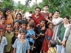 Noble act: Volunteers with children from anganwadis.