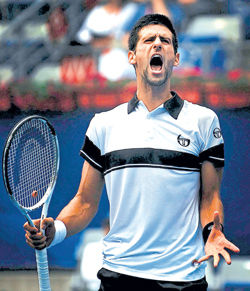 War Cry: Novak Djokovic is ecstatic after getting past Gilles Simon in the China Open on Friday. AP