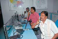 Personnel busy attending calls at the control room set up at the Deputy Commissioner's office premises in Mysore. dh photo