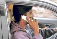 Dangerous:  Many people talk on the mobile phone while driving.