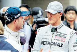 Michael Schumacher tries to put his point across to Rubens Barrichello. AP
