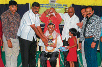 Music teacher of Vanivilas  School for Visually Impaired, M N Manjunath being  felicitated at a programme in Hassan on Sunday.   DH PHOTO