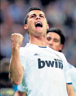 Cristiano Ronaldo of Real Madrid celebrates after scoring a goal against Racing Santander on Saturday. AP