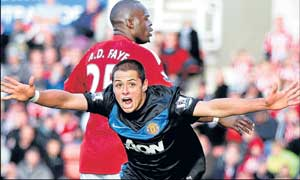 Javier Hernandez celebrates after scoring his second goal in Manchester United's 2-1 win over Stoke City in the English Premier League on Sunday. AFP