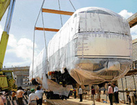 AT LAST: The first driver motor car coach arrives at Metro rail depot at Byappanahalli in  Bangalore on Monday. DH Photo