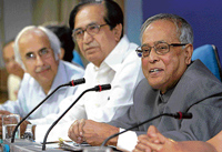 Finance Minister Pranab Mukherjee addressing the Economic Editors Conference-2010 in New Delhi on Tuesday. Minister of State for Finance Namo Narain Meena (Centre) and Finance Secretary Ashok Chawla are seen. PTI