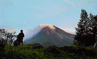 A villager watches Mount Merapi, Indonesia's most volatile volcano, in Kaliadem, Yogyakarta, on Tuesday. AP
