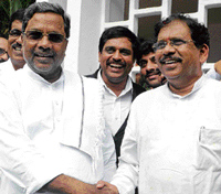 Siddaramaiah, Leader of Opposition in the Legislative Assembly receiving newly-appointed KPCC president Parameshwara, at his house in Bangalore on Wednesday. DH PHOTO