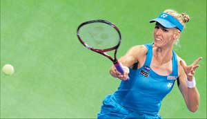 Elena Dementieva of Russia makes a forehand return during her win over Samanta Stosur of Australia in Doha on Thursday. AFP