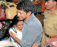 A girl hugs 'Power Star' Puneeth Rajkumar at the opening of 'Sylcon', on D D Urs road in Mysore on Thursday. dh photo