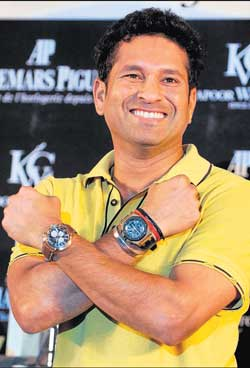 Sachin Tendulkar poses for a photo after  inking a deal with a watch manufacturer on Friday. AP