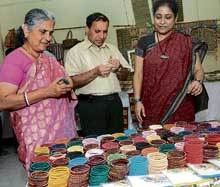 Light moment: Sudha Murthy trying on the bangles.