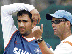 Double Impact : Gary Kirsten and skipper Dhoni provide the perfect corollary to the 'attraction of opposites' theory.