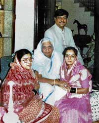 Family man: Prithviraj Chavan seen with his wife, mother and sister at his home town Karad in this file  photo. PTI