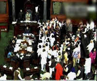 TV GRAB...........Opposition members disrupt the proceedings in Lok Sabha during the ongoing winter session of Parliament in New Delhi