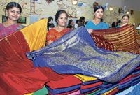 Colourful: Some of the saris on display.