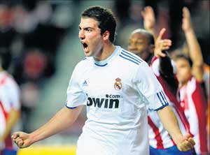 Real Madrid's Gonzalo Higuain exults after scoring his side's winner against Sporting Gijon on Sunday. AFP