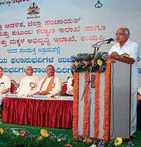 Chief Minister B S Yeddyurappa  speaking after distributing sarees to the beneficiaries of Bhagyalakshmi scheme in Udupi.