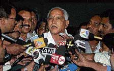 Out of focus: Chief Minister B S Yeddyurappa talks to the media at Karnataka Bhavan in New Delhi on Monday.  PTI