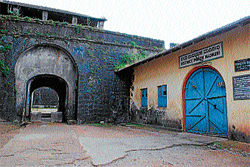 A view of Old District Prison in Madikeri. (Below) Weeds grown in the old district prison  premises. DH Photos