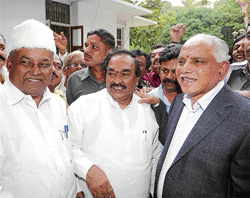 Happy times: Chief Minister B S Yeddyurappa is all smiles as he is greeted by Minister Katta Subramanya Naidu, BJP State President K S Eshwarappa and Minister Renukacharya as he arrives at his official residence on his return to Bangalore on Wednesday. Dh photo