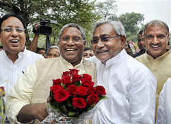 Bihar Assembly Speaker Uday Narayan Chaudhary greets Chief Minister Nitish Kumar a day after JD(U)-BJP alliance's win in assembly elections, in Patna on Thursday. PTI