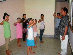 Odissi dance guru Sri Bichitrananda Swain demonstrating a posture to his students at his Odissi Dance Training School, in Mysore. DH Photo