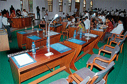 empty chairs: Corporators continue with council meeting even as BJP  councillors staged a walk out, at MCC in Mysore on Friday. DH photo