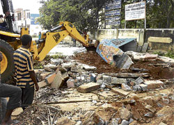 Razed: The Anjaneyaswamy Temple near Vokkaligara Bhavan in Chikkaballapur was demolished on Saturday by district administration. dh photos