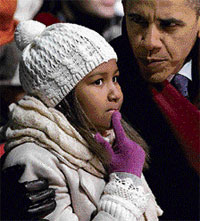 President Barack Obama and   daughter Sasha at the National Christmas Tree lighting ceremony on the Ellipse in Washington on Thursday. AP
