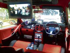 The interiors of a car with LCD screens.