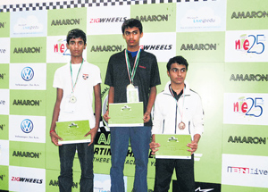 Prakriya School's Akhil Rabindra (centre) shows off his spoils along with Cathedral High School's  Darshan (left) and BCBS' Rubeel M Saleem who finished second and third respectively at the Amaron Karting Challenge.