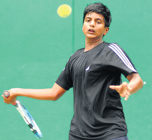 Vasudev VR plays a forehand during his win over M Arjun at the KSLTA courts on Thursday. DH photo