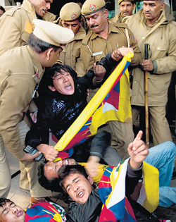 Police detain Tibetan activists as they try to approach the venue where Chinese Premier Wen Jiabao was delivering a speech in New Delhi on Thursday. AFP