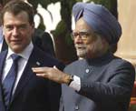 Russian President Dmitry Medvedev and Indian Prime Minister Manmohan Singh walk after talks in New Delhi, on Tuesday. AP Photo/RIA Novosti, Dmitry Astakhov, Presidential Press Service)