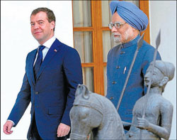 Russian President Dmitry Medvedev and Prime Minister Manmohan Singh arrive for a meeting in New Delhi on Tuesday. AFP