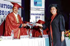 PROUD A student receiving degree certificate from the chief guest.