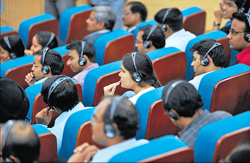 Interactive mood: Indian Institute of Technology (IIT) faculty and students listen to Russian President Dmitry Medvedev's speech using translator's headphones in Mumbai on Wednesday. AFP