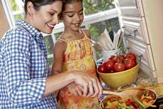 TEAM EFFORT Involve your kids in food-related activities like shopping for groceries or helping in the kitchen.