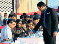 World chess champion Vishwanathan Anand at the mass chess competition at a single venue in Ahmedabad on Friday. The event set a new Guinness world record. DH photo
